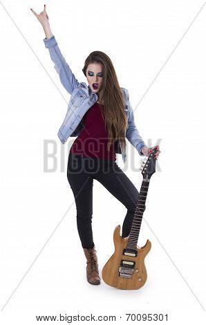 Beautiful rocker girl with electric guitar