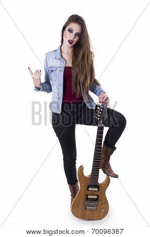 Gogeous blond rocker girl posing holding electric guitar