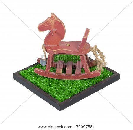 Rocking Horse In A Grass Field