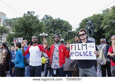 Protestors arrayed before equestrian statue