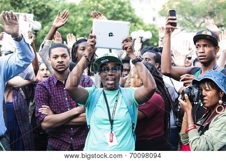 Protestor uses iPad to record events