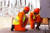 picture of substation  - two experienced electricians discussing work in electrical substation - JPG