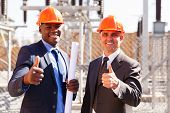 foto of substation  - portrait of electrical inspectors giving thumbs up at substation - JPG