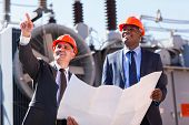 foto of substation  - professional managers working in electrical substation - JPG
