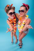 pic of hawaiian girl  - Top view portrait of two beautiful emotional coquette sexy girls with pretty smiles in pinup style with Hawaiian flowers necklaces - JPG