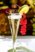 stock photo of hughes  - Champagne glass with champagne and red currant decoration - JPG