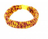 Survival Bracelet made from colorful Parachute cord using the fishtail weave poster