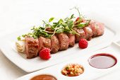 stock photo of duck breast  - grilled duck breast covered with sweet red fruit sauce - JPG