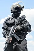 picture of anti-terrorism  - Spec ops soldier in black uniform and face mask with his rifle - JPG