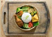 stock photo of ayam  -  Delicious nasi ayam penyet with sambal belacan - JPG