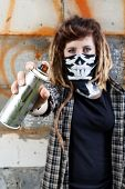 foto of hooligans  - Young female hooligan holding graffiti spray can in hand