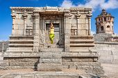 stock photo of vijayanagara  - Woman doing yoga in ruined temple near Lotus Mahal in Hampi Karnataka India - JPG