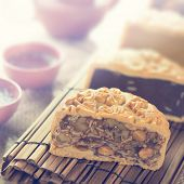 picture of mid autumn  - Traditional mooncakes on table setting with teacup - JPG