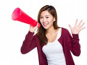 stock photo of yell  - Asian girl yell with megaphone - JPG