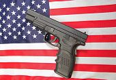 pic of mayhem  - View of automatic pistol set on US flag - JPG