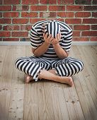 pic of prison uniform  - portrait of a repentant man prisoner in prison uniform - JPG