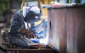 foto of welding  - welder working with electrode at semi - JPG