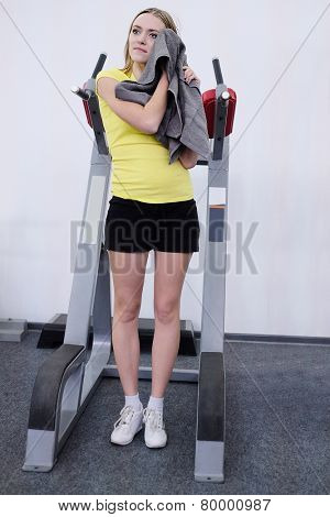 girl with a towel after a workout in the gym