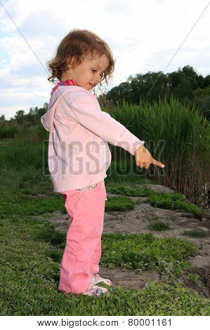 Girl ashore lake.