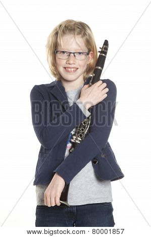 Young Blond Girl Holds Clarinet In Studio