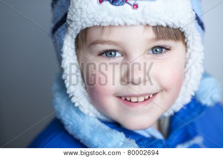 Cute blond caucasian boy smiling