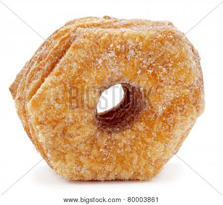 a croissant-doughnut pastry sprinkled with sugar on a white background