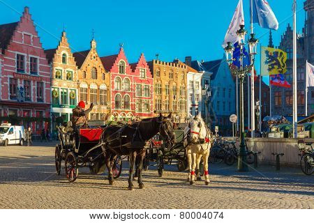 Horse carriage waiting tourists on Grote Markt square of Brugge