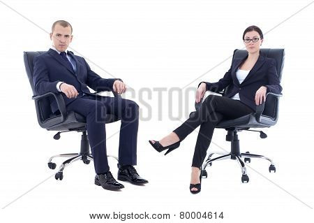 Young Man And Beautiful Woman In Business Suits Sitting On Office Chairs Isolated On White