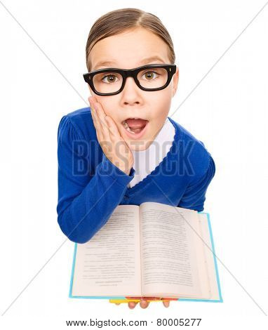 Funny little girl is holding books and open her mouth in astonishment, fisheye portrait, isolated over white