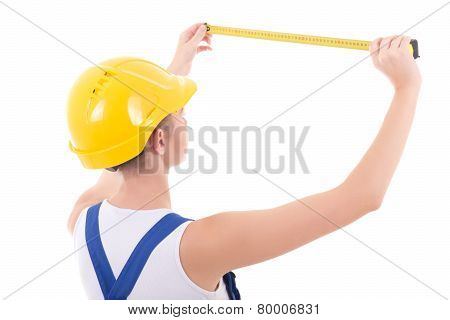 Young Beautiful Woman Builder In Blue Coveralls With Measure Tape Isolated On White