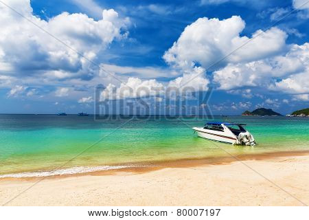 White Boat On A Beautiful Beach