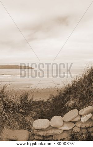 Sepia Stone Wall Shelter On A Beautiful Beach