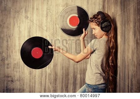 Cute happy teen girl enjoys the music in headphones. Generation. Studio shot.