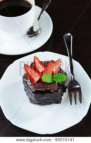Yummy chocolate cupcake on table, close-up