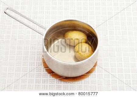 Boiled potatoes in a saucepan