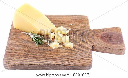 Crumbled Parmesan cheese with sprig of rosemary on cutting board isolated on white