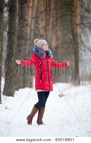 Happy Smiling Female In Red Winter Jacket Rejoicing Outdoors