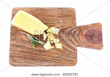 Crumbled Parmesan cheese with sprig of rosemary isolated on white