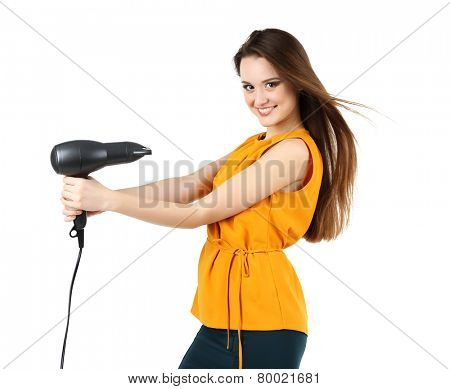 Beautiful young woman with long hair holding hair dryer isolated on white