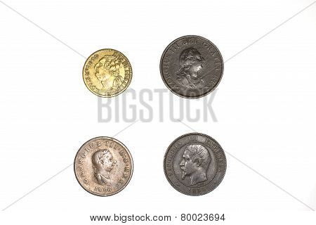 Four Old Copper Coins On White Background