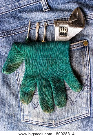 Wrench, Gloves And A Screwdriver In Jeans Pocket.
