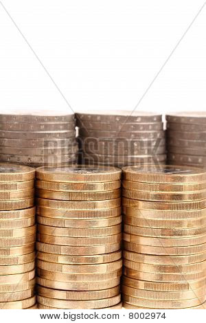 Coins organized in columns and rows isolated on white background