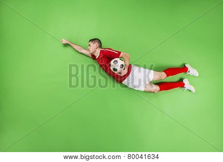 A football player in superman pose
