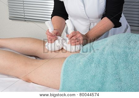 Man Having Ayurveda Massage With Herbal Ball.