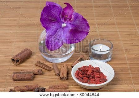 Orchid Flower And Candle On Zen Pebble