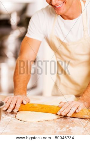 Man Rolling Out The Dough.
