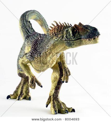 Un enorme dinosaurio Allosaurus se levanta contra blanco