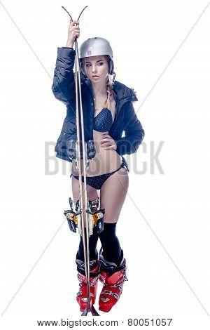 Girl is posing with ski