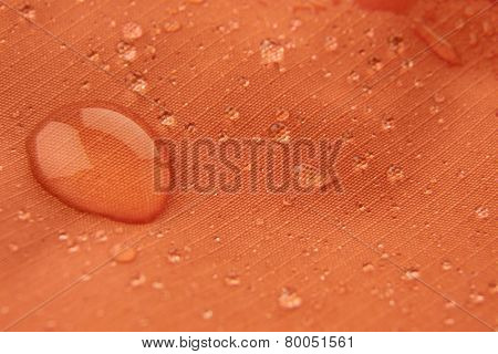 Orange waterproof coating background with water drops