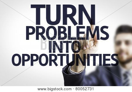 Business man pointing to transparent board with text: Turn Problems into Opportunities